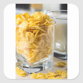 Glass of dry cereal and a glass of milk square sticker