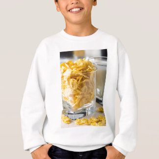 Glass of dry cereal and a glass of milk sweatshirt