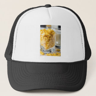 Glass of dry cereal and a glass of milk trucker hat