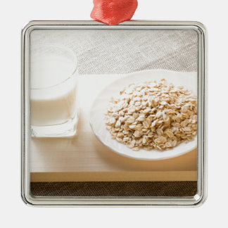 Glass of milk and a plate of cereal closeup Silver-Colored square decoration