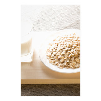 Glass of milk and a plate of cereal closeup stationery