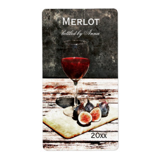 Glass of red wine with figs wine bottle label