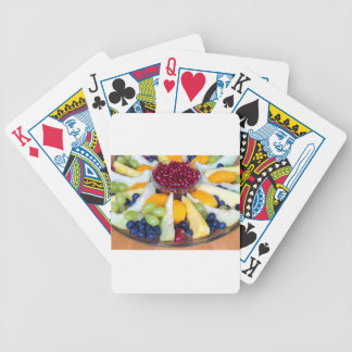 Glass scale full of various fresh fruits bicycle playing cards