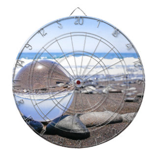 Glass sphere on stones at beach and coast dartboard