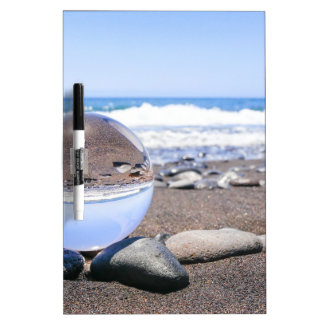 Glass sphere on stones at beach and coast Dry-Erase whiteboard