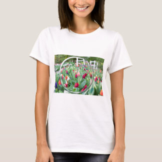 Glass sphere reflecting tulips flowers T-Shirt