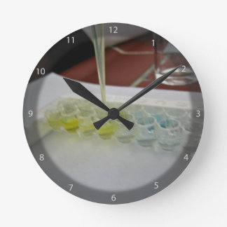 Glass vessels with colorful solutions round clock