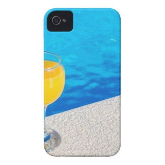 Glass with orange juice on edge of swimming pool iPhone 4 Case-Mate case