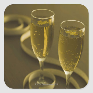 Glasses of champagne square sticker