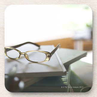 Glasses on the book drink coaster