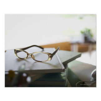 Glasses on the book poster