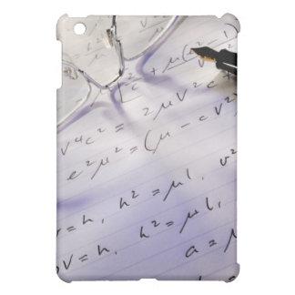 Glasses, pen and mathematical symbols on paper, iPad mini cover