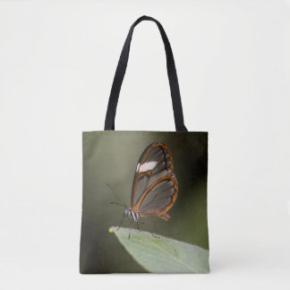 Glasswinged butterfly on a leaf tote bag