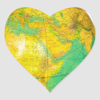 Globe with planet earth isolated on white heart sticker