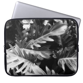 Glowing black and white tropical leaves laptop sleeve