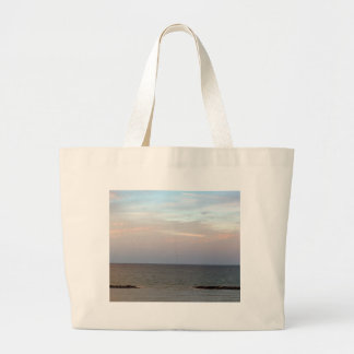 Glowing clouds over the Adriatic Sea in Italy. Large Tote Bag