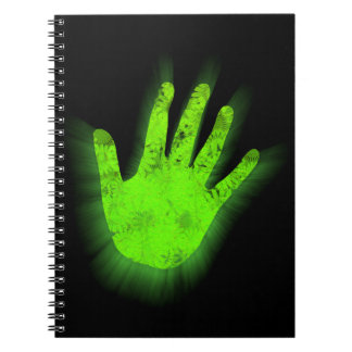 Glowing hand print. notebook