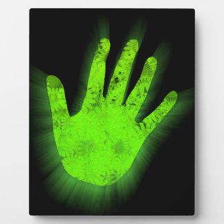Glowing hand print. plaque