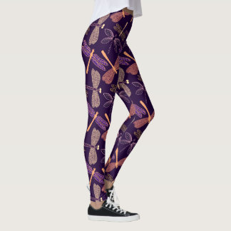 Glowing night dragonflies on dark plum background leggings