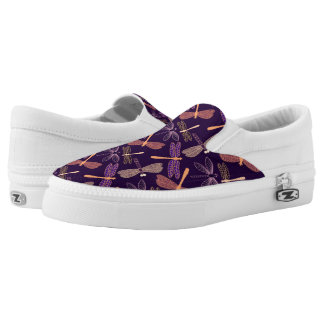 Glowing night dragonflies on dark plum background slip on shoes