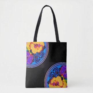Glowing tropical hibiscus on dramatic black tote bag