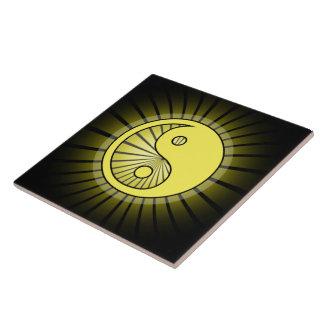Glowing Yellow Yin Yang over Black Ceramic Tile