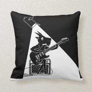 Goat playing an electric guitar cushion