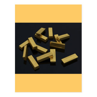Gold bars in bulk on a black background post card