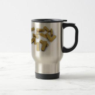 Gold bars in bulk on a white background travel mug
