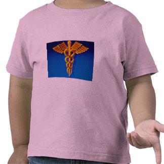 Gold caduceus over blue medical background t-shirts