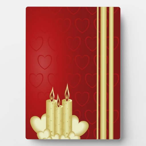 Gold candles and red hearts on red plaques
