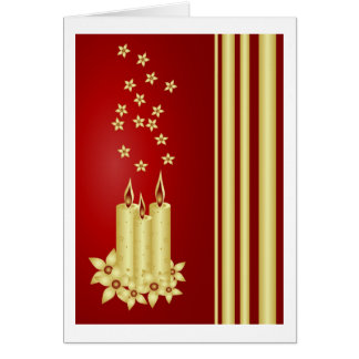Gold candles, flowers and stars on red greeting card