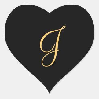Gold-colored initial J on black monogram sticker