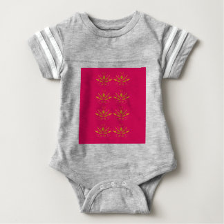 Gold elements on pink baby bodysuit