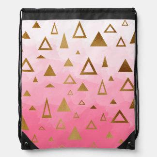 gold geometric triangles pastel pink brushstrokes drawstring bag