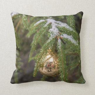 Gold Glass Christmas Ornament On Evergreen Tree Cushion