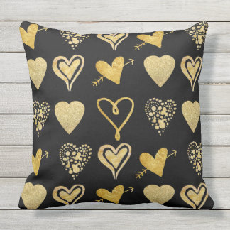 gold hearts pattern on black outdoor cushion