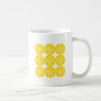 Gold lemons on white coffee mug