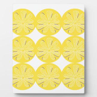 Gold lemons on white plaque