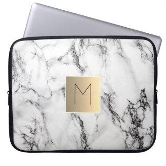gold monogram on marble laptop sleeve