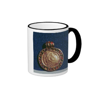 Gold pendant in the form of a coin coffee mugs