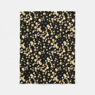 Gold polka dots on a black background . fleece blanket