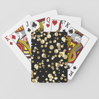 Gold polka dots on a black background . playing cards
