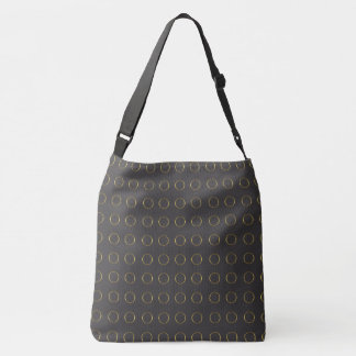 Gold rings on black crossbody bag