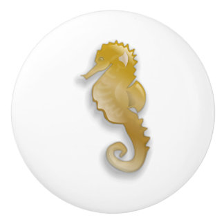 GOLD SEA HORSE ON A CERAMIC KNOB