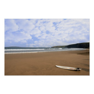 golden beach with lone surfboard poster