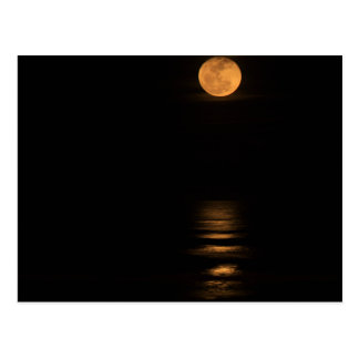 golden full moon over ocean postcard