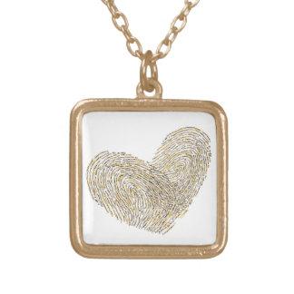 Golden heart text design thumbprint jewelry