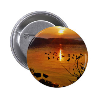 Golden lake sunset with geese pins
