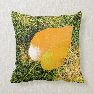 Golden leaf on grass throw pillow